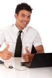 большие пальцы руки nepalase бизнесмена поднимают детенышей Стоковая Фотография