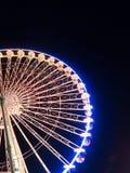 Большое колесо на ярмарке потехи на ноче Стоковое фото RF