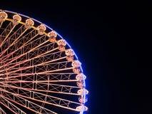 Большое колесо на ярмарке потехи на ноче Стоковые Фото