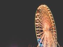 Большое колесо на ярмарке потехи на ноче Стоковые Фотографии RF