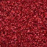 Большое количество красных декоративных sequins Запачканное фоновое изображение с сияющим bokeh освещает от малых элементов котор Стоковая Фотография