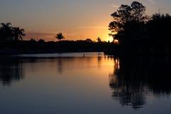 большой заход солнца пеликана Стоковые Изображения
