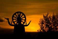 большой заход солнца статуи Будды Стоковые Фото