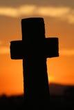 Большой крест на заходе солнца Стоковые Изображения