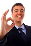 Большой пец руки молодого бизнесмена идя вверх стоковая фотография