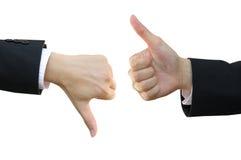 Большой пец руки поднимающий вверх и большой пец руки вниз Стоковое фото RF