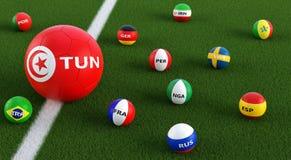 Большой футбольный мяч в цветах Туниса национальных окруженный более малыми футбольными мячами в других национальных цветах Стоковая Фотография RF