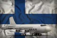 Бомбардировщик на предпосылке национального флага Финляндии иллюстрация 3d Стоковая Фотография