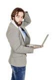 Бородатый бизнесмен с портативным компьютером человеческая эмоция срочная Стоковая Фотография