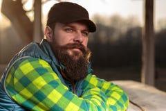 Бородатый фермер на заходе солнца Стоковые Фотографии RF