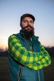 Бородатый фермер на заходе солнца Стоковое Фото