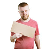 Бородатый человек держа знак в его руках стоковые изображения
