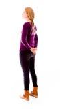 Бортовой профиль молодой женщины думая с руками позади назад стоковое фото