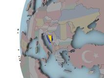 Босния с флагом на глобусе иллюстрация вектора