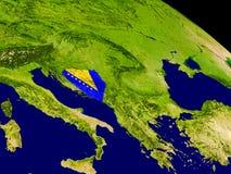 Босния с флагом на земле Стоковое Изображение