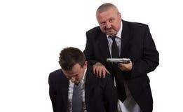 Босс и молодой работник в конфликте Стоковое Изображение