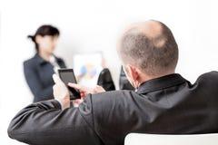 Босс проверяя заказы Стоковое фото RF