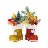 2 ботинка Санта Клауса с украшениями рождества Стоковые Фотографии RF
