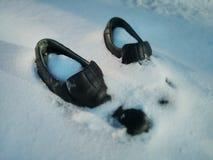 Ботинки в снеге Стоковая Фотография