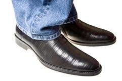 ботинки джинсыов вниз Стоковая Фотография