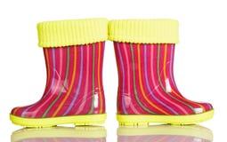 Ботинки детей резиновые при inset ткани изолированный на белизне Стоковые Изображения