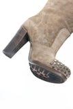 Ботинки женщин бежевой высоко-накрененные замшей Стоковые Изображения RF