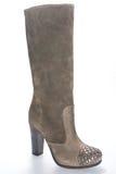 Ботинки женщин бежевой высоко-накрененные замшей Стоковые Изображения