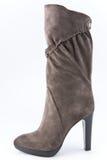 Ботинки женщин коричневой высоко-накрененные замшей Стоковая Фотография
