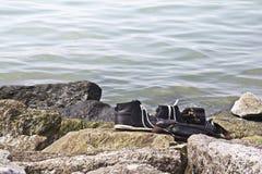 Ботинки на камне Стоковая Фотография