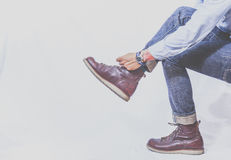 Ботинки с джинсами Стоковая Фотография