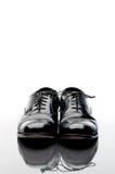 ботинки черного дела кожаные стоковое фото