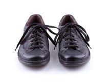 Ботинки черных кожаных людей Стоковая Фотография