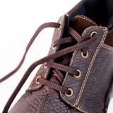 ботинки шнурков крупного плана предпосылки белые стоковые изображения