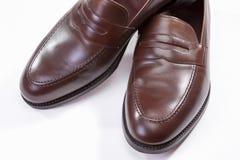 Ботинки Loafer Брайна Пенни против белой предпосылки Горизонтальная ориентация изображения Стоковые Фото