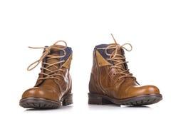 Ботинки ` s людей классические коричневые кожаные изолированные на белой предпосылке Стоковая Фотография RF