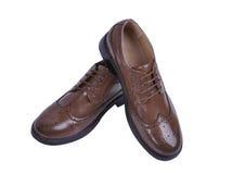 Ботинки ` s людей классические коричневые кожаные изолированные на белой предпосылке Стоковое Изображение RF