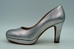 Ботинок высоко-накрененный серебром стоковые фото