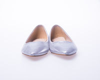 ботинок Серебряные ботинки женщины моды цвета на предпосылке Стоковая Фотография RF