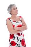 Более старая заинтересованная женщина изолированная в красной & белом Стоковая Фотография RF