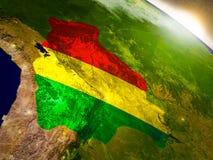 Боливия с флагом в восходящем солнце Стоковые Изображения