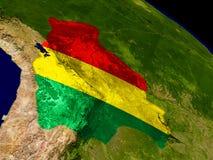 Боливия с флагом на земле Стоковые Фото