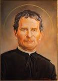 Болонья - портрет изящного искусства Святого Дон Bosco p Porporato (2008) в церковь барокк Dom - St Peters Стоковые Изображения