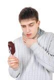 Больной подросток с мороженым Стоковое фото RF