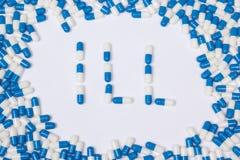 Больной текст слова сделанный голубых таблеток, пилюлек и капсул стоковое фото rf