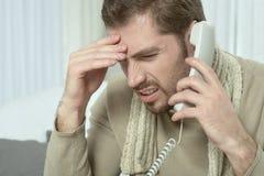Больной человек вызывая его доктора Стоковое фото RF