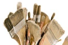Изолированные используемые щетки краски Стоковые Изображения