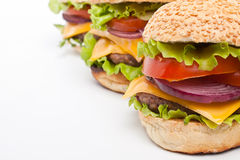 Большие вкусные cheeseburgers Стоковые Изображения