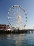Большие колеса туристическая достопримечательность на портовом районе Сиэтл Стоковые Фотографии RF