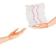 Большие пакеты долларов в деревянной изолированной руке Стоковое фото RF