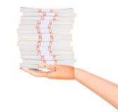 Большие пакеты долларов в деревянной изолированной руке Стоковые Фотографии RF